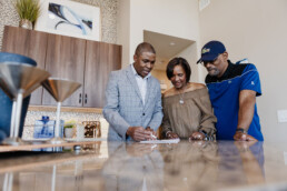 ERA agent helping a couple purchase a home