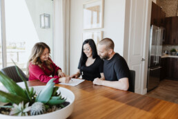 Real estate agent helping young couple understand the market