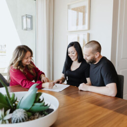 Realtor helping family sign papers for a new home