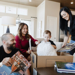 Happy family packing after selling their home