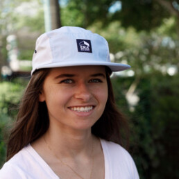 Girl wearing light blue ERA 5 panel hat